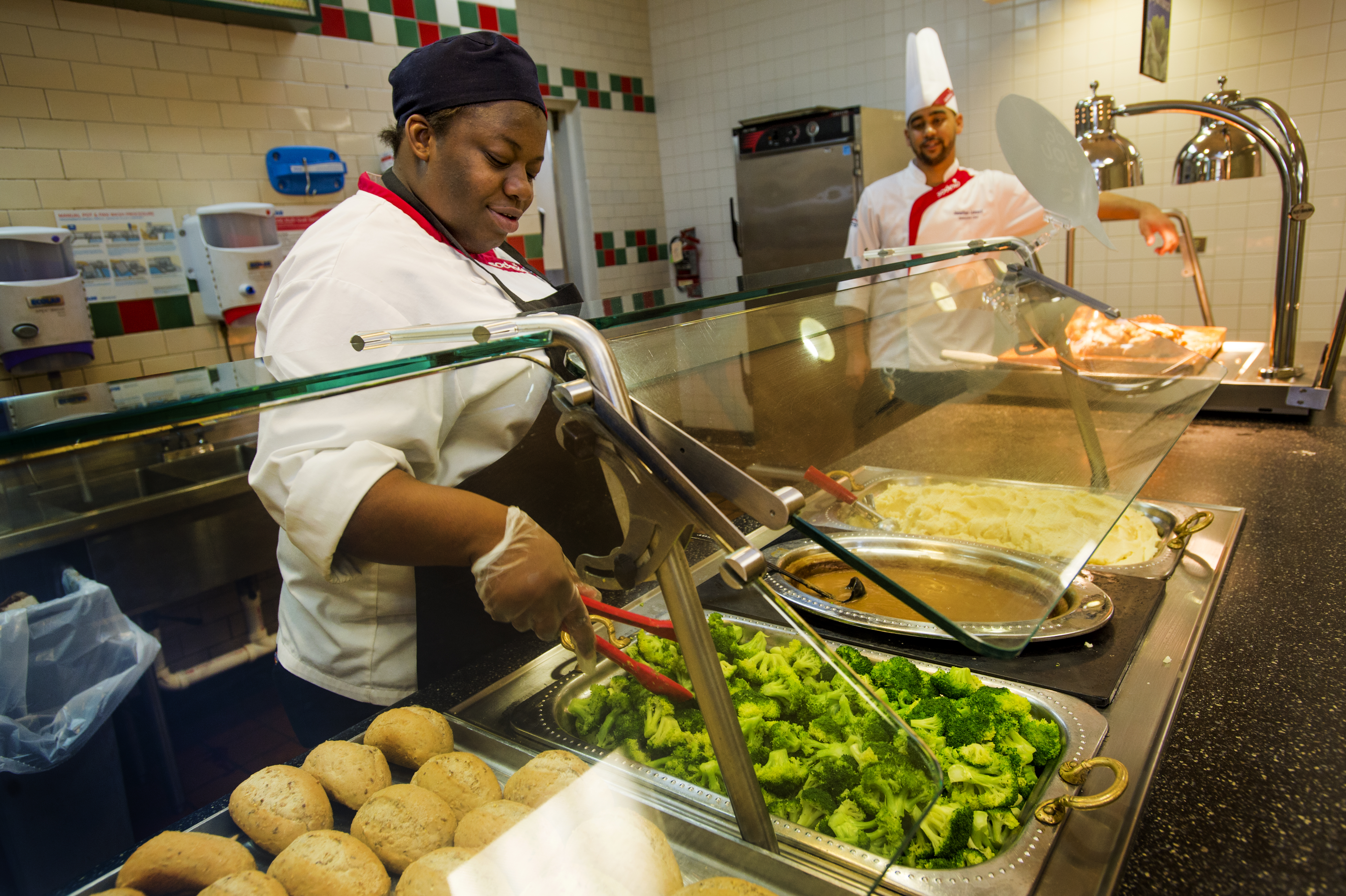 Tulane dining hall worker behind counter.